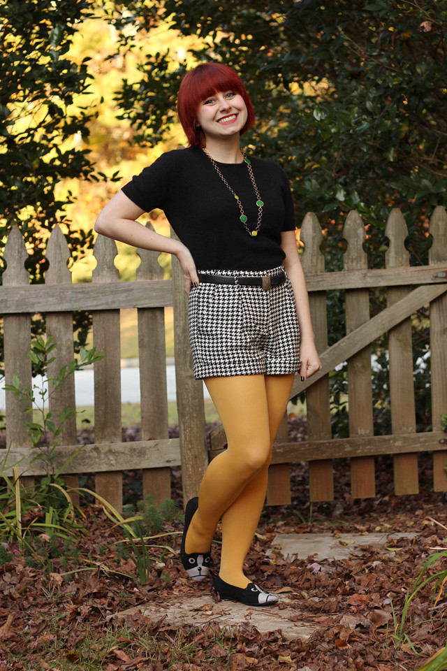 Black Short Sleeved Sweater, Houndstooth Shorts, and Yellow Tights