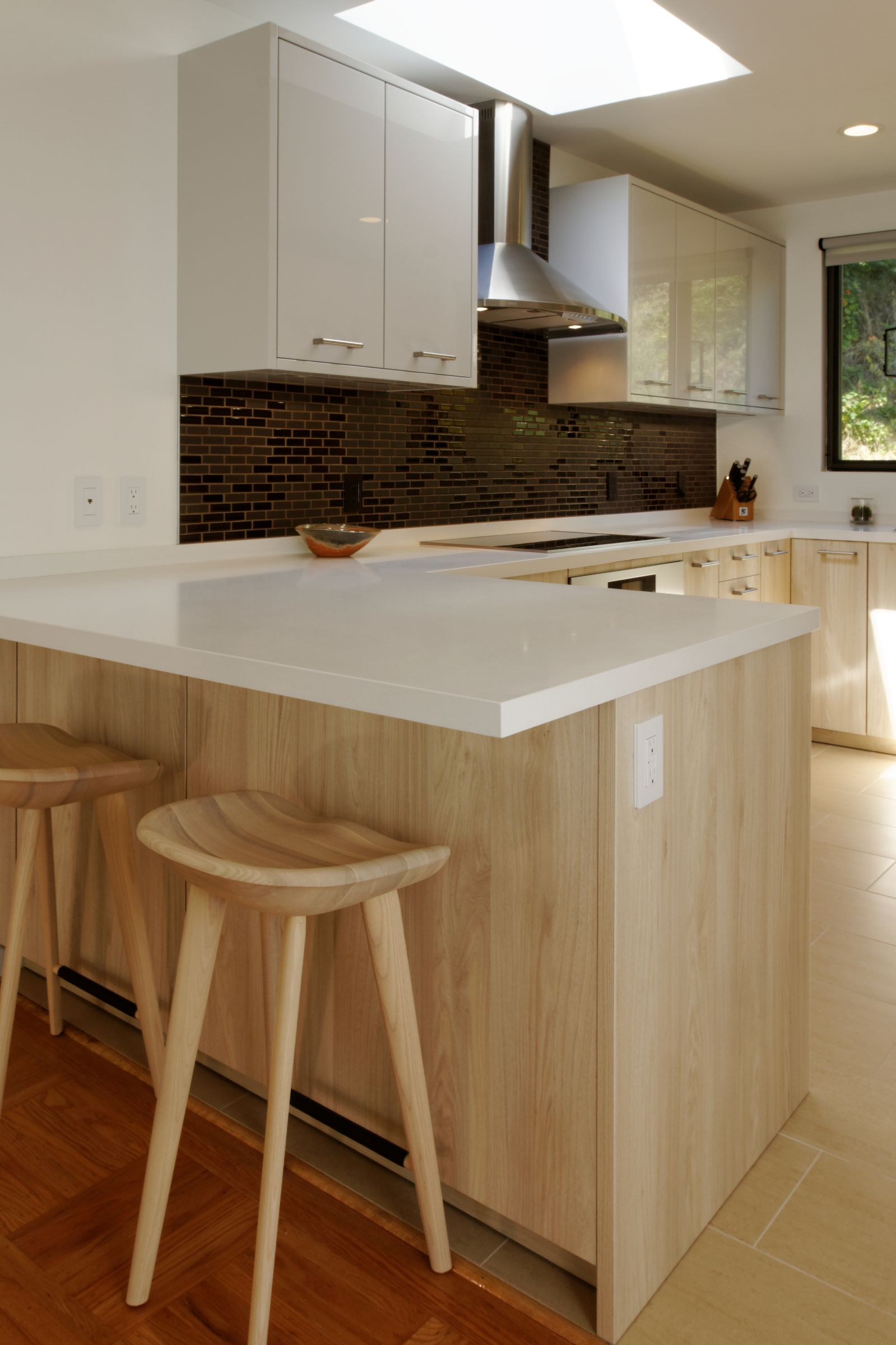 By keeping the bar area at counter-height, the area feels even larger.