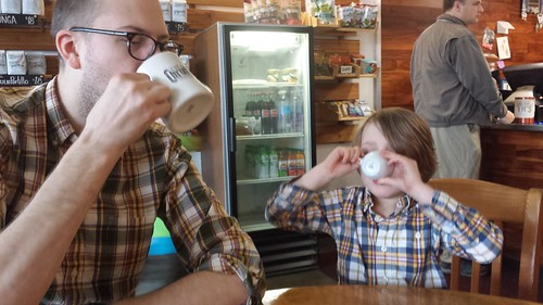 Two guys drinking coffee