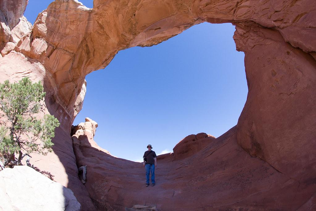 Ken standing under Broken Arch