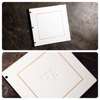 Custom square graphic design portfolio book with engraving and gold color fill treatment
