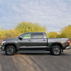 chevrolet silverado(0.0), luxury vehicle(0.0), automobile(1.0), automotive exterior(1.0), pickup truck(1.0), wheel(1.0), vehicle(1.0), truck(1.0), toyota tundra(1.0), bumper(1.0), land vehicle(1.0),