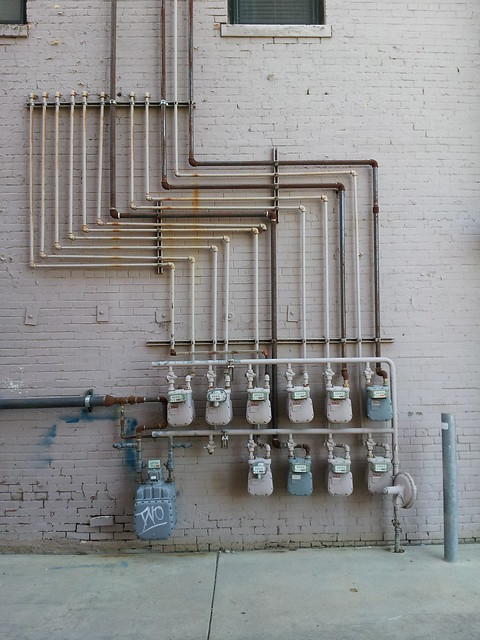 pipes and meters along a wall