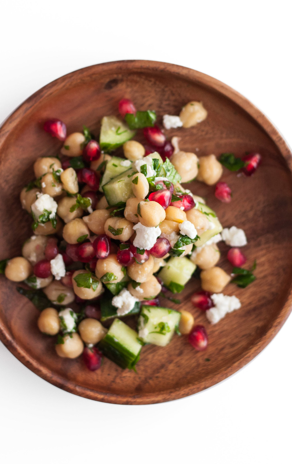 Quick, easy, and super healthy chickpea salad with juicy pomegranate seeds. Perfect #glutenfree party side dish.