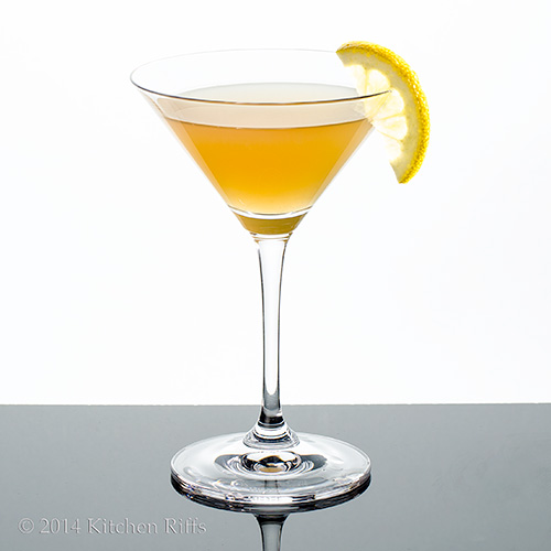Harvest Moon Cocktail in cocktail glass with lemon slice garnish
