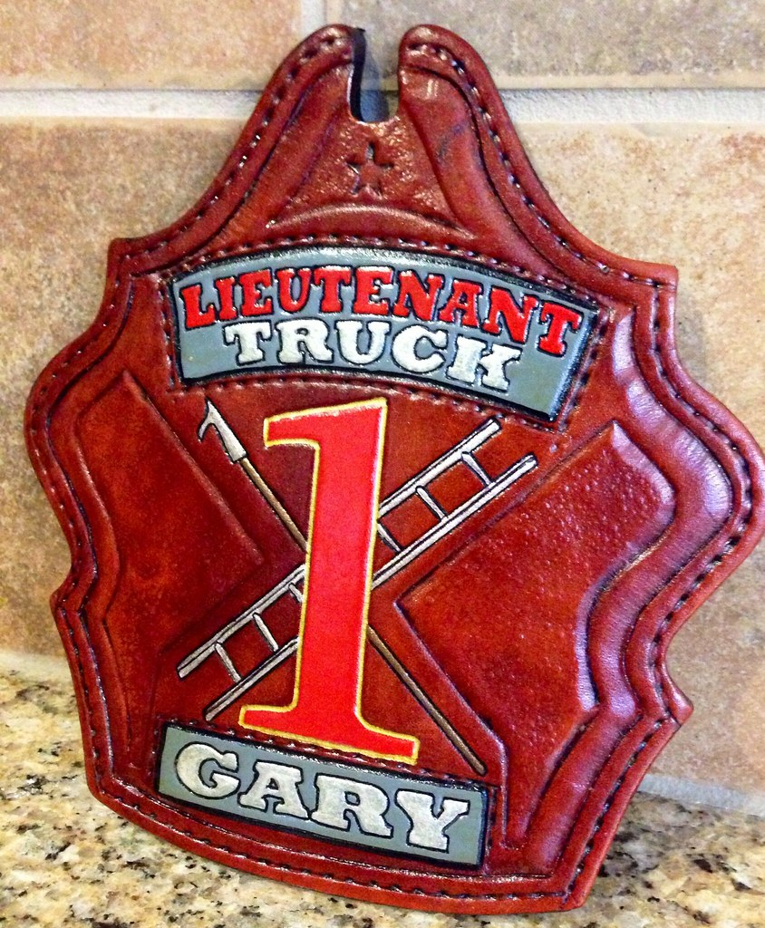 Truck style fire helmet shield with antique finish