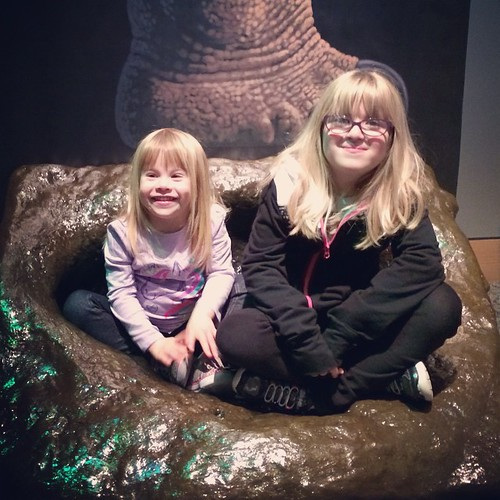 2 girls in a dinosaur footprint. #WLDinoNC