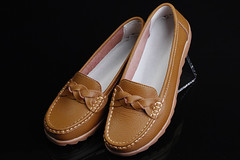 outdoor shoe(0.0), textile(0.0), limb(0.0), leg(0.0), brown(1.0), footwear(1.0), shoe(1.0), leather(1.0), tan(1.0), slip-on shoe(1.0),