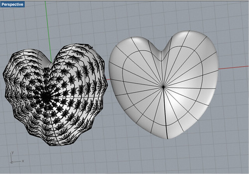Two heart shapes for a locket to contain electronics