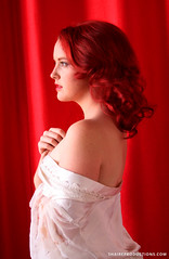 Redhead Woman Portrait with Red Drapery