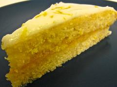 citrus(0.0), lemon(0.0), plant(0.0), produce(0.0), fruit(0.0), buttercream(1.0), yellow(1.0), baked goods(1.0), food(1.0), sponge cake(1.0), icing(1.0), dish(1.0), dessert(1.0), cuisine(1.0),