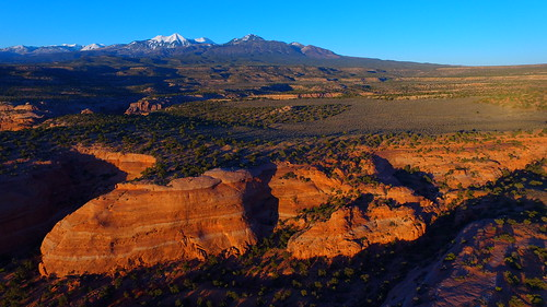 trees sunset cliff usa mountains art nature rock forest landscape utah unmodified spring unitedstates desert artistic outdoor bluesky canyon erosion vista northamerica redrocks rockymountains southernutah springtime rockformations unedited rockformation drone snowcappedmountains moabutah nofilters noadjustments dji straightoffthecamera lasaljunction quadcopter phantom3professional