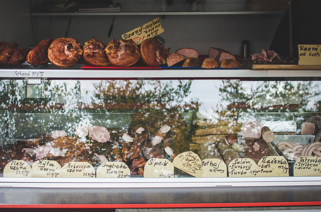 Sausage and other meats at the butcher's stall in the Vinohrady Farmer's Market in Prague, Czech Republic.
