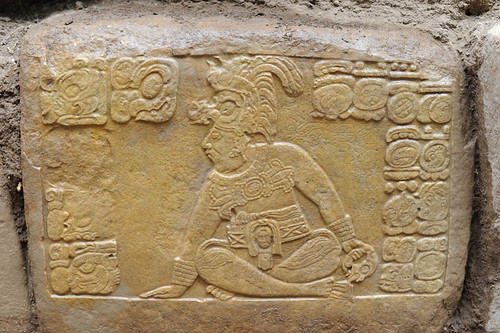 A seated Maya king from the La Corona stairway. (© Proyecto La Corona)