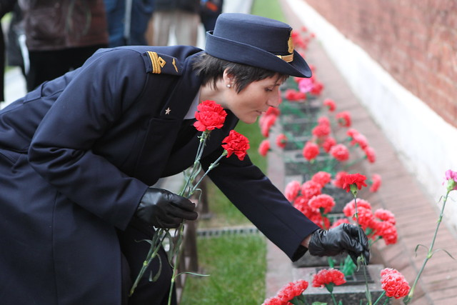Laying flowers at Yuri Gagarin's grave
