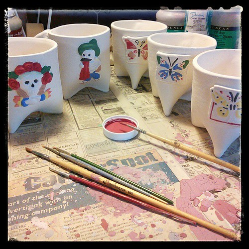 Second coat, in progress. #ceramics #mugs #painting