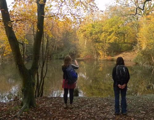 By a tree by a pond