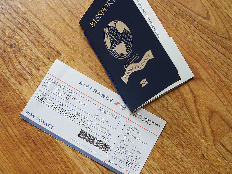 Nathan's passport and plane ticket