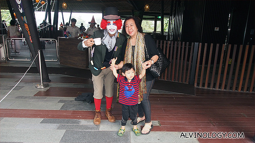 My mum and Asher with a staff from River Safari during a Halloween event last year