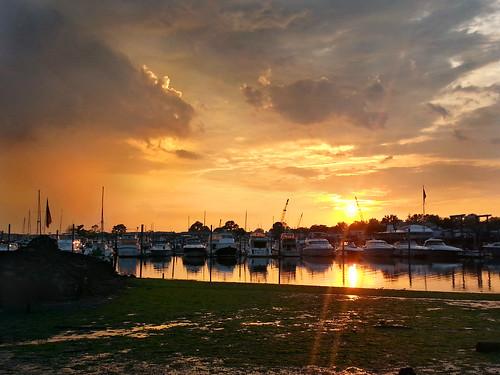 ocean sunset sky orange clouds marina boats bay harbor twilight dock yacht flag shoreline longisland shore northshore lowtide sailboats magichour goldenhour cowbay shoreroad portwashingtonny manhassetisle