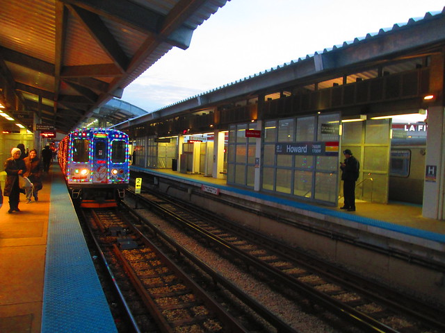 Yellow Line Holiday Train approaches Howard 'L' station's northbound platform