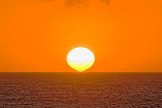 Twin suns on the  horizon in the Atlantic Ocean