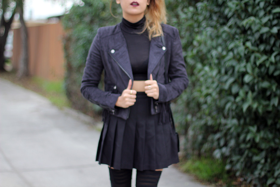 Salsit moto jacket, turtleneck crop top, American Apparel pleated skirt, Zara studded boots, Rag & Bone Mini Pistol, Walford Stay Up Thigh High tights