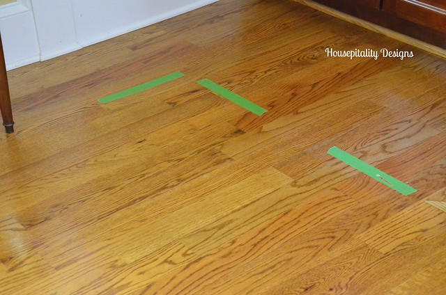 Prepping for the placement of a rug pad-Housepitality Designs