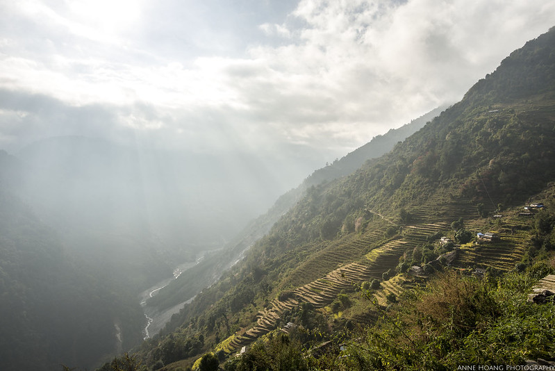 Annapurna base camp trek in Nepal - cepuscular rays of light through the clouds