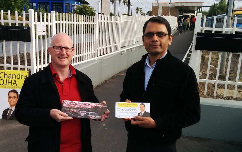 Supporter of Labor, and independent candidate Chandra Ojha, handing out flyers at Bentleigh station
