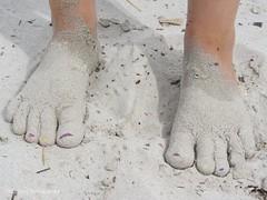 hand(0.0), finger(0.0), human body(0.0), pattern(1.0), sand(1.0), barefoot(1.0), limb(1.0), leg(1.0),