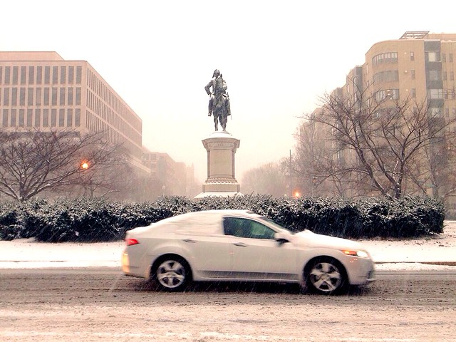 Snow-covered car on Scott Circle