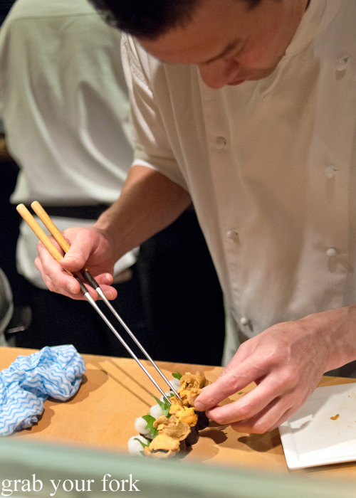 Chef Takashi Sano adding uni sea urchin roe to gunkan maki battleship sushi at Sokyo at The Star, Pyrmont