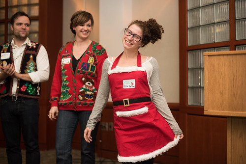 UT PGE graduate student Ruth Hahn poses for the crowd during the ugly sweater contest at the department holiday party.