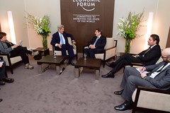 U.S. Secretary of State John Kerry, joined by Under Secretary of State for Economic Growth, Energy, and the Environment Catherine Novelli, left, sits with Cyprus President Nicos Anastasiades and his advisers on January 23, 2015, before the two sat down for a bilateral meeting on the sidelines of the World Economic Forum in Davos, Switzerland. [State Department Photo/Public Domain]