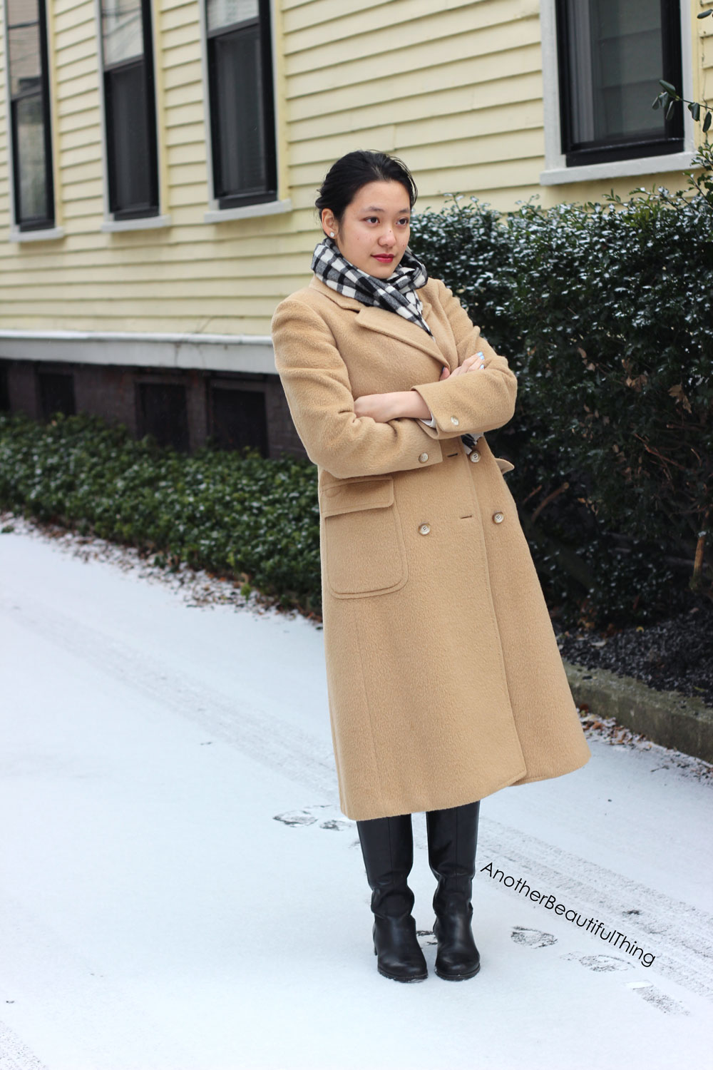 Long knee length camel coat and black and white checked scarf