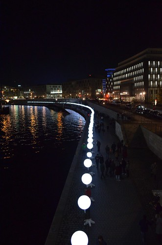 Berlin Fall of The Wall 25 Year Anniversary Lichtgrenze_ lit balloons at night along Spree river from Bundestag