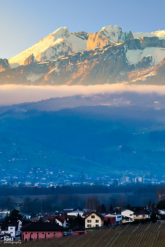blue houses sunset shadow orange mountain snow mountains alps yellow buildings valley liechtenstein thealps vaduz