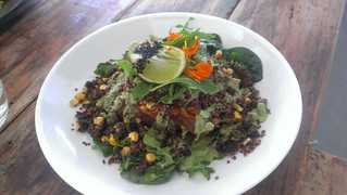Stuffed Sweet Potato with Chipotle Black Bean Corn Salsa, Avocado Cream and Dressed Greens at Greenhouse Factory