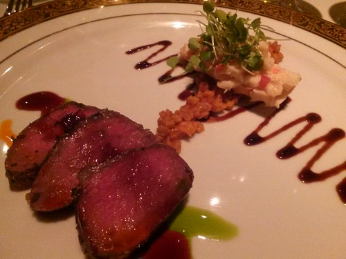 Seared Lamb Loin Chervil Buttered King Crab Marrow, Citrus Pea Shoots,  Red Pepper Farro, Barrel Aged Port Reduction