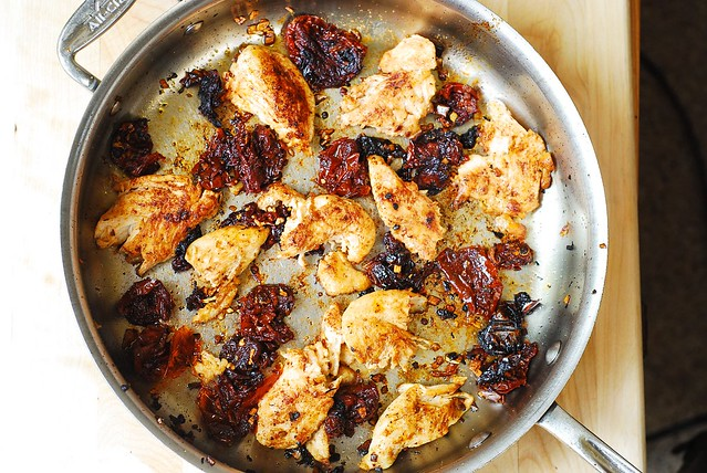 cooking chicken with sun-dried tomatoes and crushed red pepper