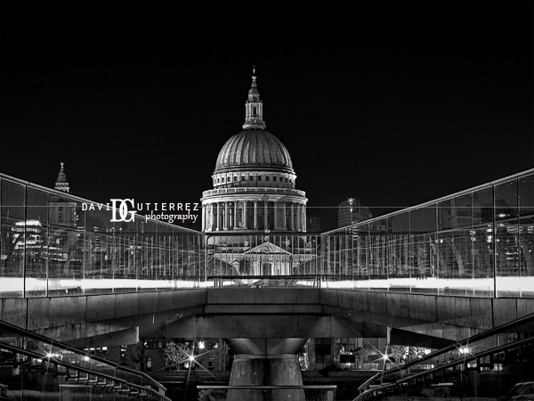 St pauls cathedral and millennium bridge london at night in black and white photography