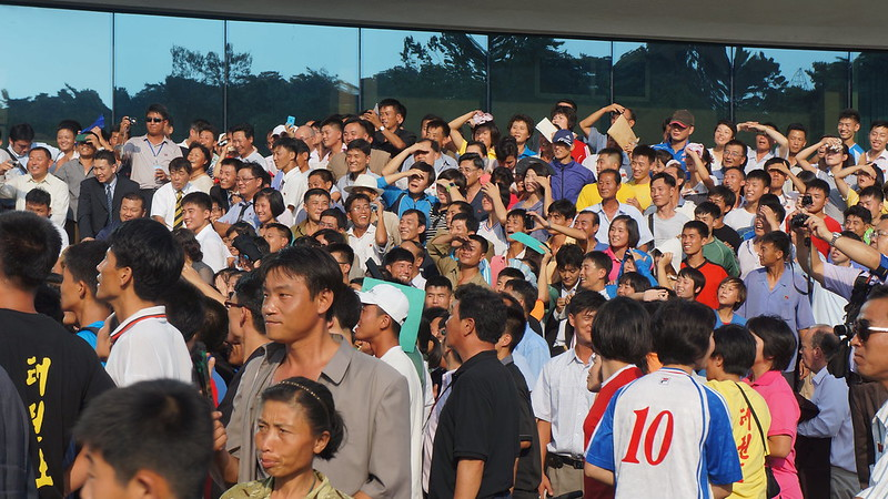 Pro-wrestlers including The Beast entertain a crowd of North Koreans