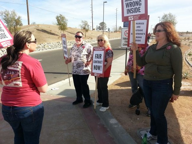 A California Nurses Association representative and registered nurses from Barstow Community Hospital picket for fair bargaining outside the hospital in March