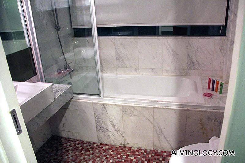 Spacious bathroom with tub. See the cute toiletries?