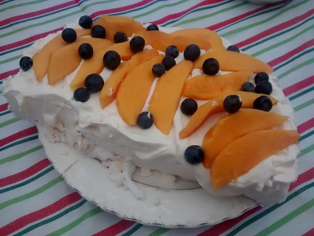 pavlova with mango and blueberries and cream