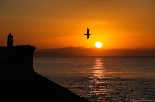 uk sea orange wales sunrise dawn coast harbour cymru porthcawl
