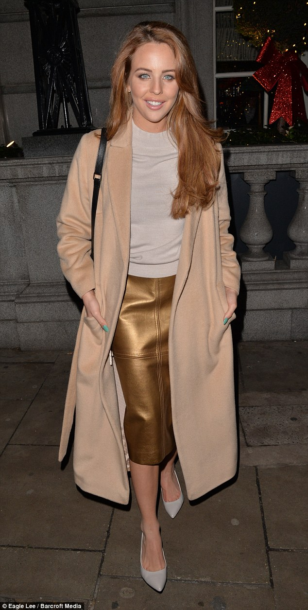Camel-duster-coat-with-a metallic-gold-pencil-skirt