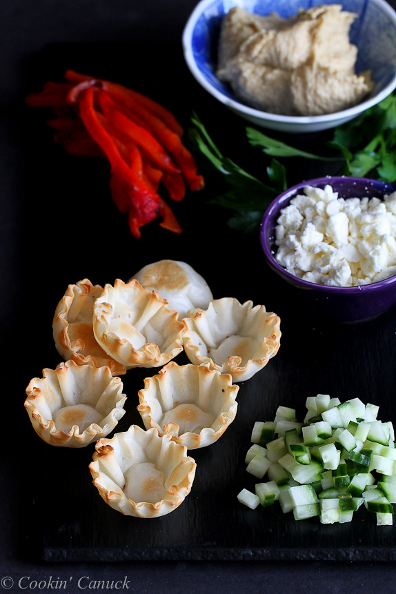 Mini Hummus and Roasted Pepper Phyllo Bites...Quick and easy appetizers! Only 67 calories and 2 Weight Watcher SmartPoints | cookincanuck.com #recipe #vegetarian