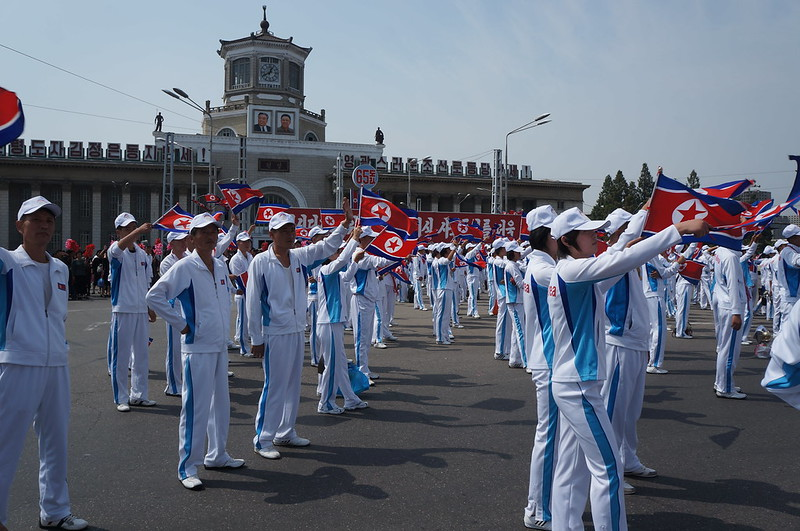 North Korean sports team watching military parade procession for September 2013 National Day